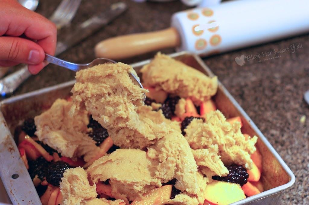 cobbler dough on top of blackberries