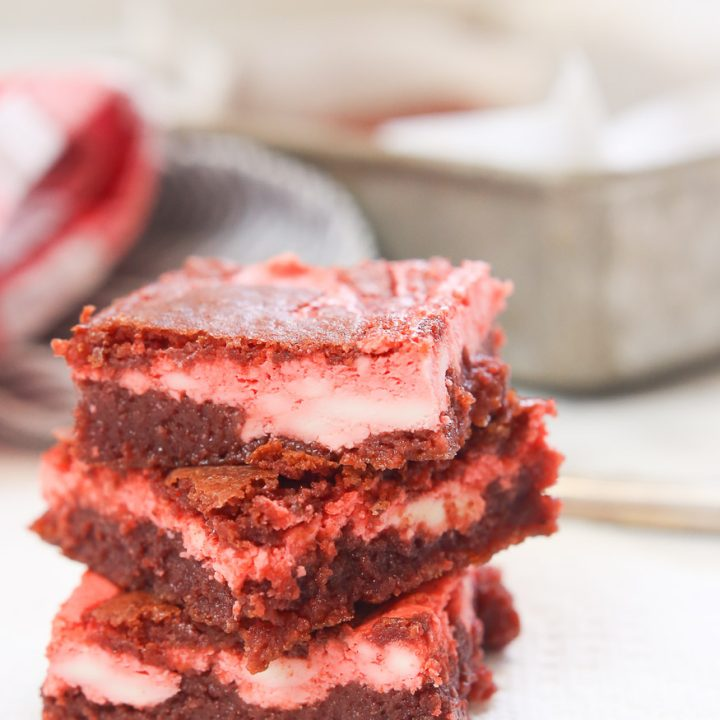 Moist and delicious gluten free red velvet cheesecake bars are quick and easy to make, are extremely creamy and decadent, and are perfect when you are in the mood for a little indulgence! There is still plenty of time to whip these up before Valentine's Day y'all!