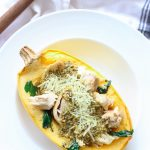 Gluten free pesto chicken spaghetti squash bowls are easy and delicious to put together! Fresh baked spaghetti squash gets a makeover once topped with pesto, juicy chicken pieces, and melty cheese!