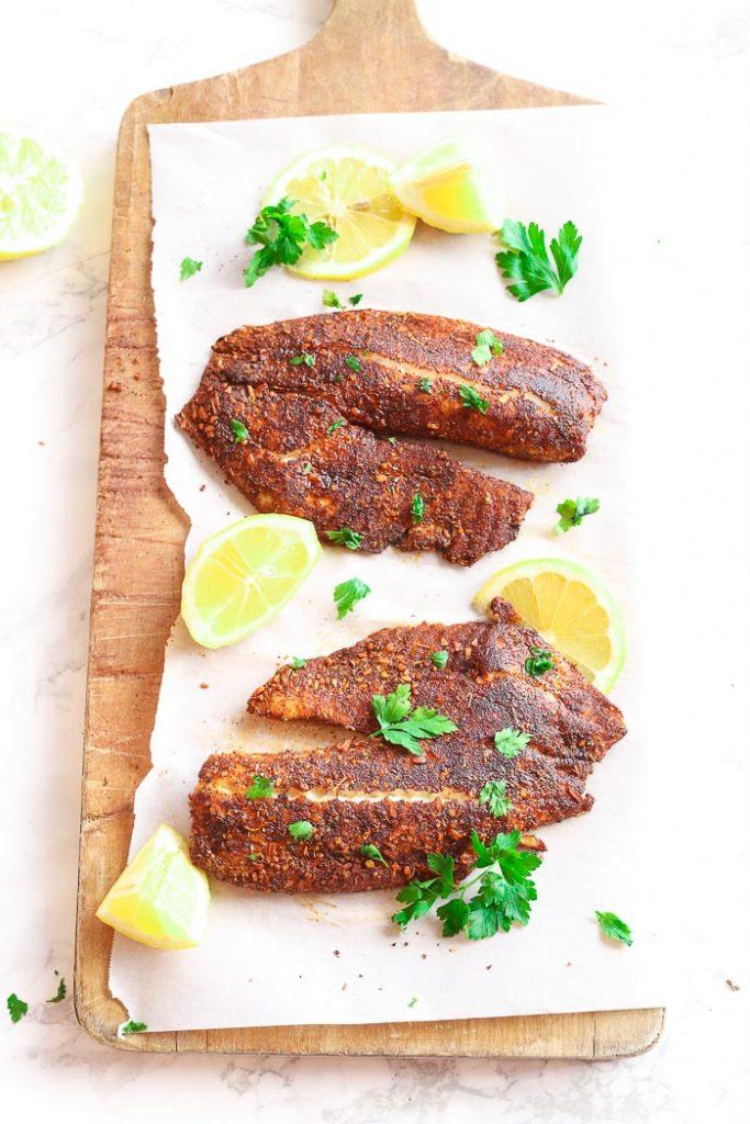 blackened fish on cutting board