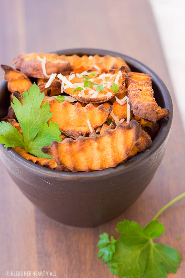 These baked parmesan sweet potato fries are amazingly easy to make with simple ingredients. The hints of savory garlic and parmesan blend perfectly with the sweetness of the sweet potato pieces!