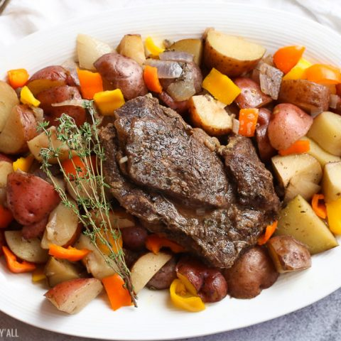 A summer slow cooker pot roast slowly simmers a generous beef roast with hearty potatoes and summer's fresh vegetables in a broth swimming with garlic, onion, thyme, and oregano. Keep cool and let your crock pot do all the hard work!