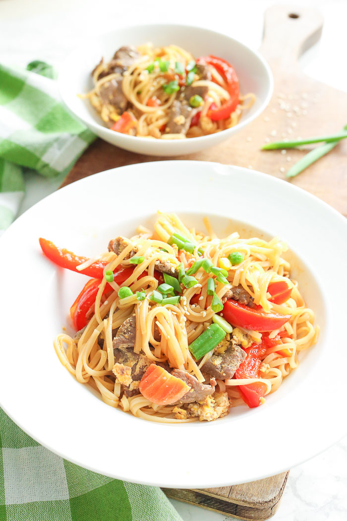 beef pad thai in white serving bowls