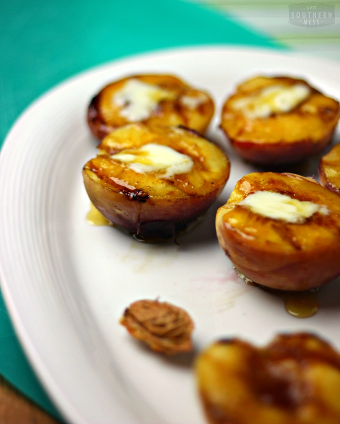 This grilled Georgia Peaches recipe is a simple and delicious dessert that tastes just as decadent and succulent with a healthy twist alternative. www.ahotsouthernmess.com