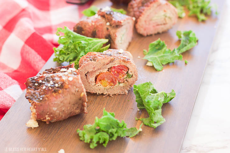 These grilled spicy steak pinwheels use a mixture of cotija cheese, grape tomatoes, pepper flakes, and arugula leaves all wrapped up in some yummy thinly-sliced steak. The drooling starts now! www.BlessHerHeartYall.com