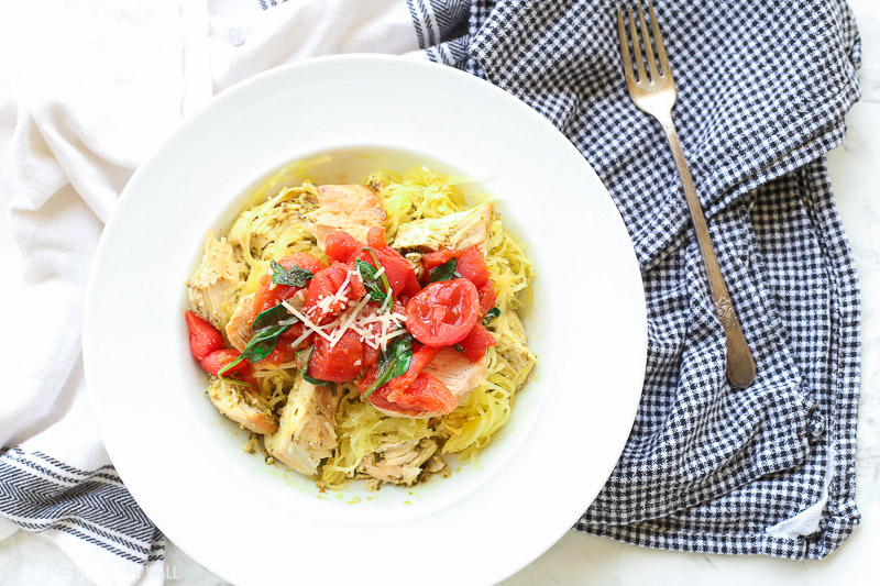 This spinach tomato spaghetti squash recipe combines fresh fluffy spaghetti squash and tops it with an easy and quick spinach and tomato sauce that's so garlicky and savory, the perfect combination of a healthy tasty meal!