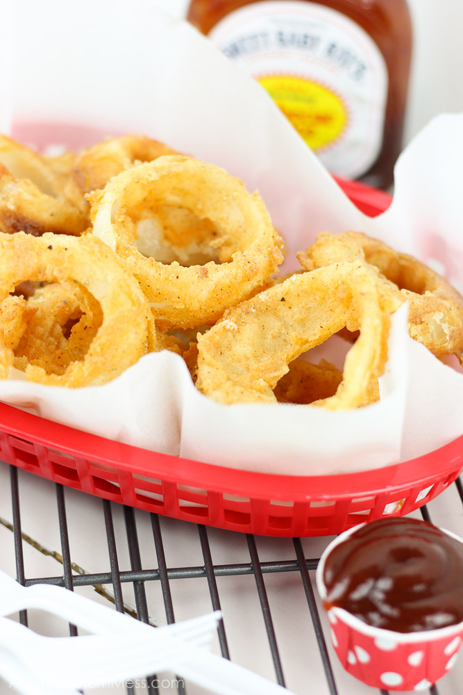 Crunchy, crispy, and barbecue-y! These BBQ and Buttermilk Onion Rings are easily made at home with just a few simple ingredients and in only minutes! www.ahotsouthernmess.com