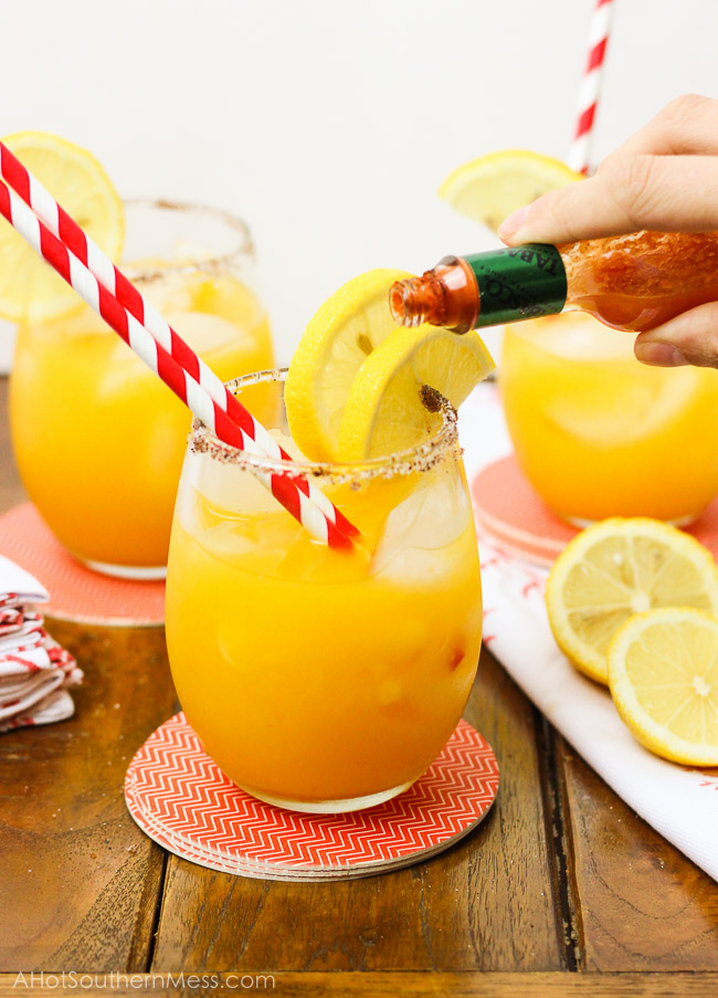 A sweet refreshing twist on summer lemonade. The fusion of mango and chili powder along with a splash of hot sauce, add a fun spicy summer twist {oh, and did I forget to mention the chili powder and sugar-laced rims? How dare me???}. And for those of us 21 or older, the addition of white rum makes this sipping cocktail a fruity delight! www.ahotsouthernmess.com