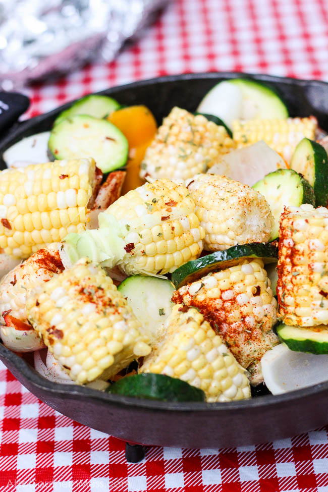 What an easy and healthy recipe! These fresh sweet veggies are placed on the grill in a cast iron skillet, drizzled with olive oil and sriracha, and then sprinkled with more fire with crushed red pepper flakes, before being toasted to perfection. The end result is sweet and spicy tender veggies with a hint of the grill and a bit of crispity crunch. www.ahotsouthernmess.com