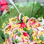 A refreshingly spicy late-summer salad, full of sweet corn, crisp radishes, spicy jalapeño slices, fresh Italian parsley, and chopped sweet red onions. A combination of chipotle chili pepper, fresh lime juice, garlic and coriander make this dish stand out even more than it's brilliant colors. Just five minutes of time will produce this colorful and refreshing delight that is perfect as an autumn side dish or party food. www.ahotsouthernmess.com