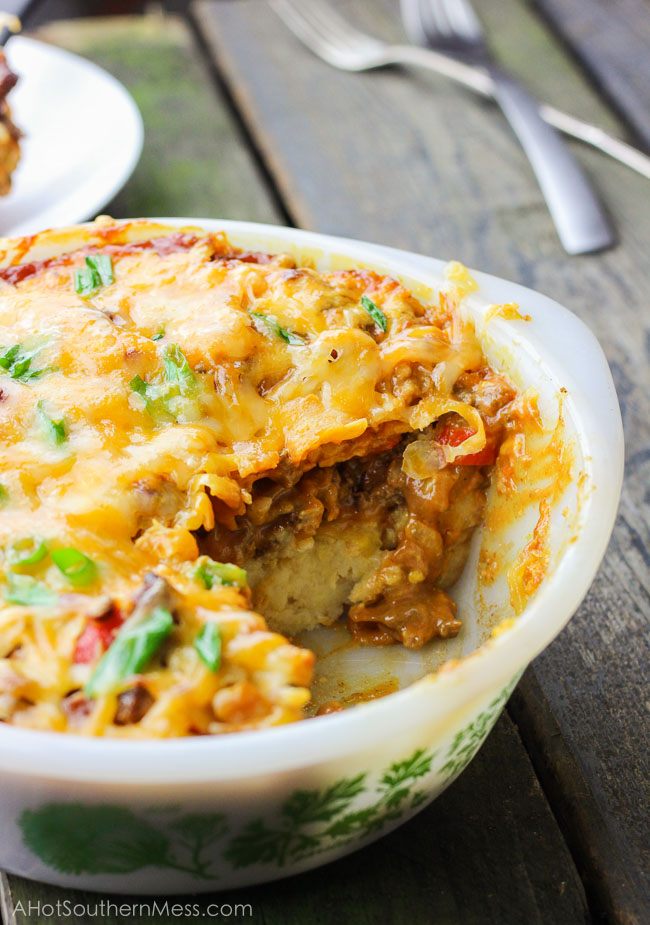 This gluten-free spicy sloppy joe cornbread casserole is the best combination of sweet and tangy with hot and spicy. It's meaty and breaded, saucy and doughy. The tangy and spicy sloppy joe sauce is thick and smooth {and a little bit messy} and coats the beef, veggies, and cornbread and then baked until the melty cheese is stringy and ooey gooey. This comfort food casserole is amazing for when you need to reach for an easy weeknight meal that the whole family will love. www.ahotsouthernmess.com