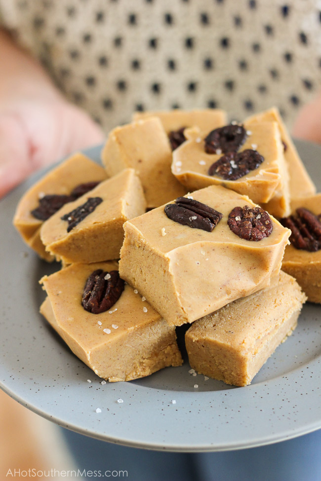 These easy and quick White Chocolate Pumpkin Fudge with Bourbon-Brown Sugar Roasted Pecans are perfect for impressing your friends at your next fall party or get together! www.ahotsouthernmess.com