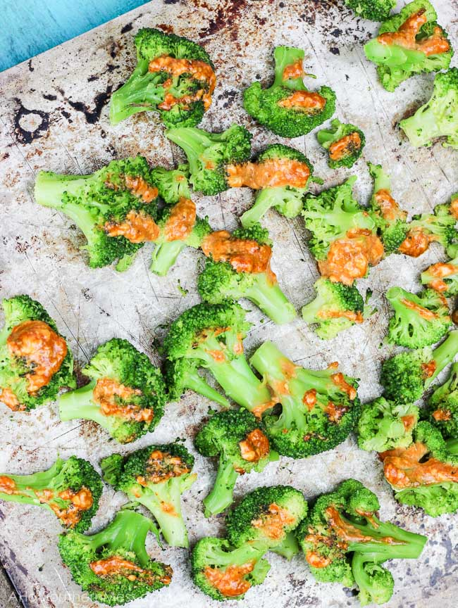 Roasted sriracha cream broccoli is an easy and quick combination of fresh broccoli florets drizzled in a sriracha lime cream sauce and then roasted until fragrant and tender in the oven. This spicy and creamy veggie side will kick your meal times up about 100 notches. www.ahotsouthernmess.com