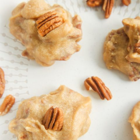 close up of pecan pralines on white dish