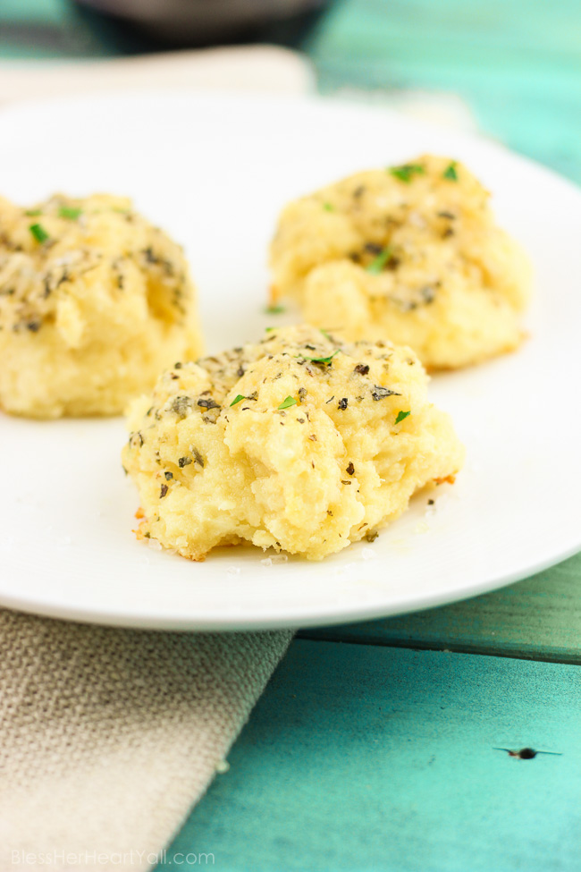 Soft gooey rolls that are topped with a fresh garlic butter sauce then sprinkled with parmesan and coarse sea salt and then smothered in garlic butter once again. These gluten-free bites are a quick and easy game-changer for any meal that they are served with! www.blessherheartyall.com