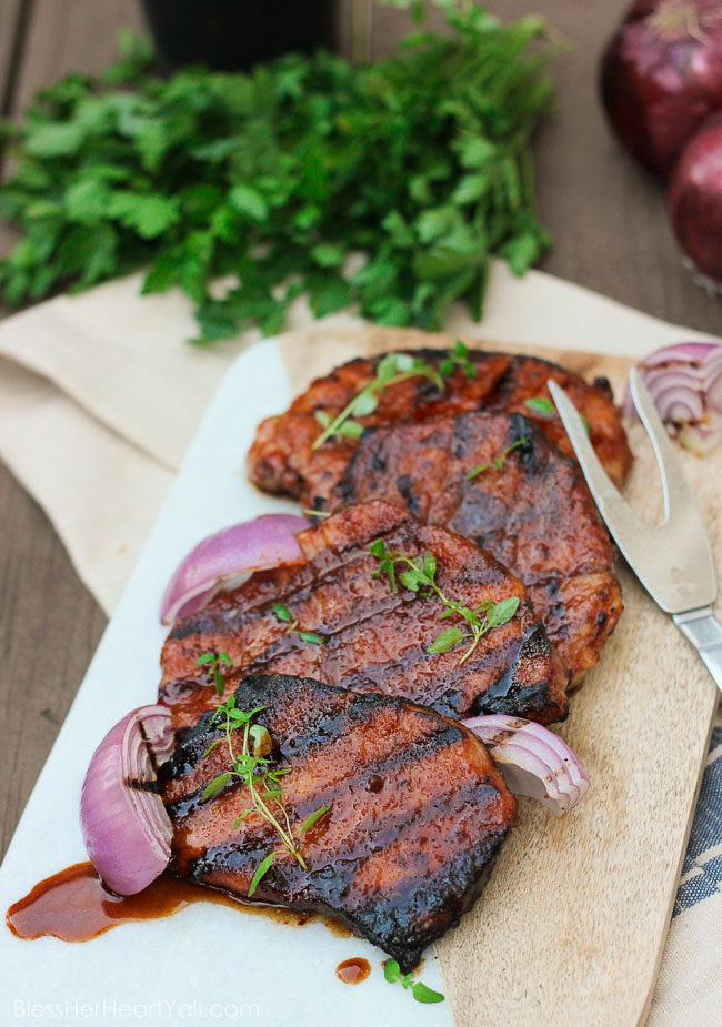 These gluten-free southern cayenne glazed pork chops are an easy 5-ingredient recipe that combines the sweetness of brown sugar with the spiciness of cayenne pepper. A few minutes marinating and then quickly kissed on the grill, these southern glazed pork chops create a tender, juicy, flavorful meal in just minutes! www.blessherheartyall.com