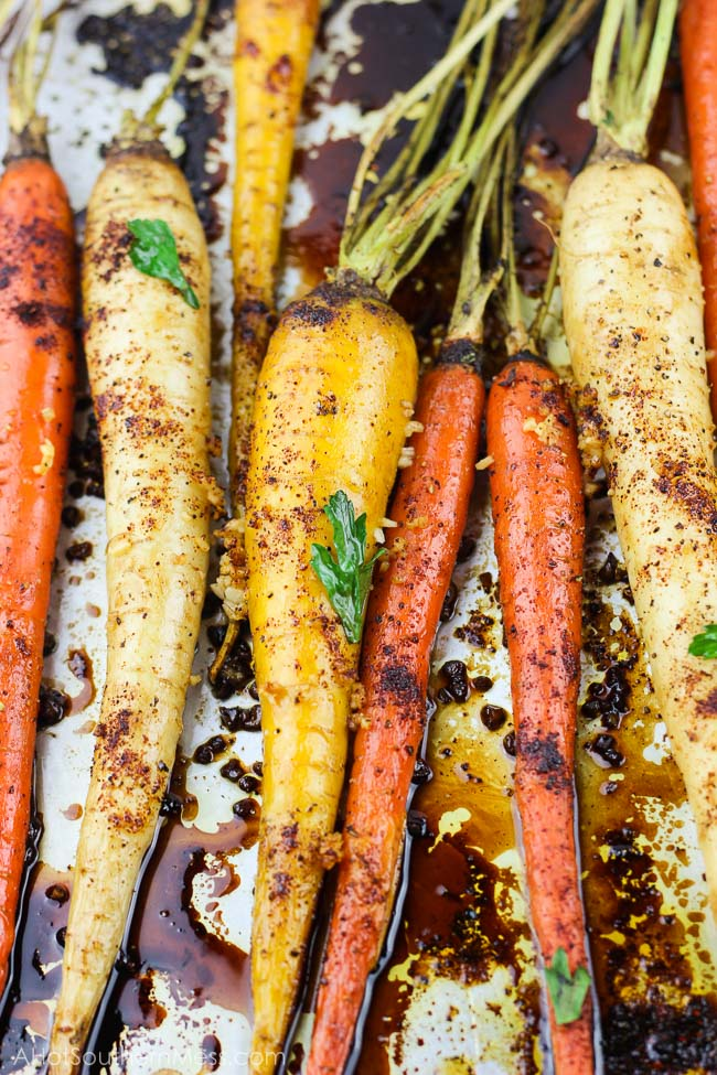 With 5 minutes of prep work and a couple of simple ingredients, these spicy honey garlic roasted carrots are an easy gluten-free fall side dish that is both full of flavor and healthy. With the combination of chili powder, garlic, and honey, with an easy balsamic glaze drizzle, you have both a sweet and spicy, tender yet crunchy vegetable for your table spread. www.ahotsouthernmess.com