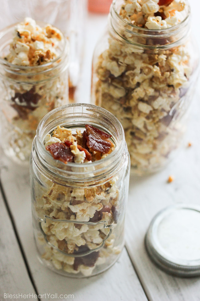 This maple, bacon, bourbon popcorn hits all the right spots, with it's freshly popped popcorn, sprinkled with thick-cut applewood bacon, and then drizzled with butter, salt, maple syrup, and of course bourbon! It's a quick, easy, and inexpensive DIY gift for friends, co-workers, and host/hostess's this holiday season! www.blessherheartyall.com DIY Hostess Gift: Maple, Bacon, Bourbon Popcorn