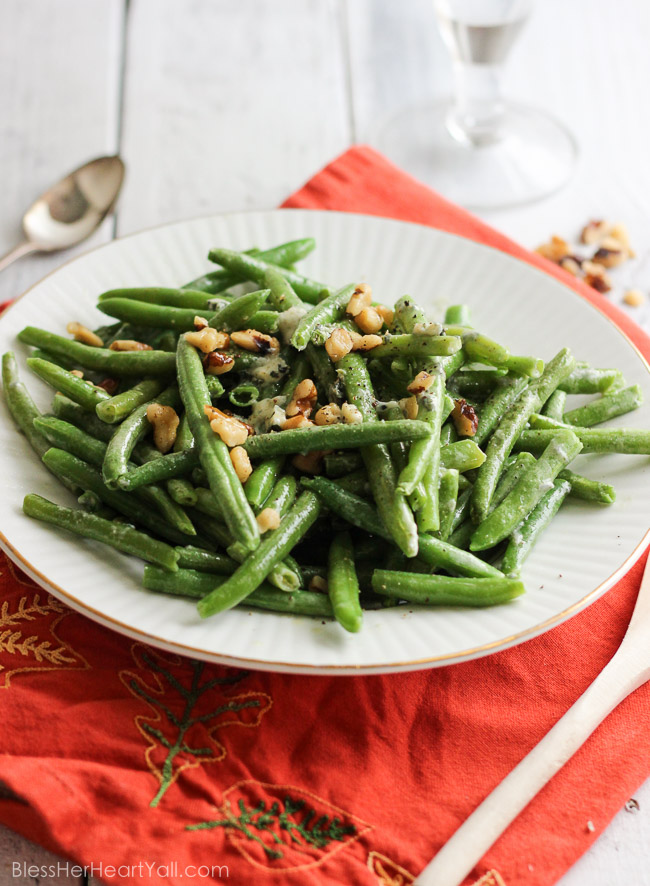 easy bleu cheese green beans Fresh green beans are prepared {can be prepared in TWO ways!} with a decadent blue cheese sauce drizzled and stirred over top for a warm, hearty, cheesy, creamy addition to your holiday table. And the best part? It will look like you had been in the kitchen sweating to make this dish happen, when in reality… it was soooooo easy-peasy. | www.blessherheartyall.com|