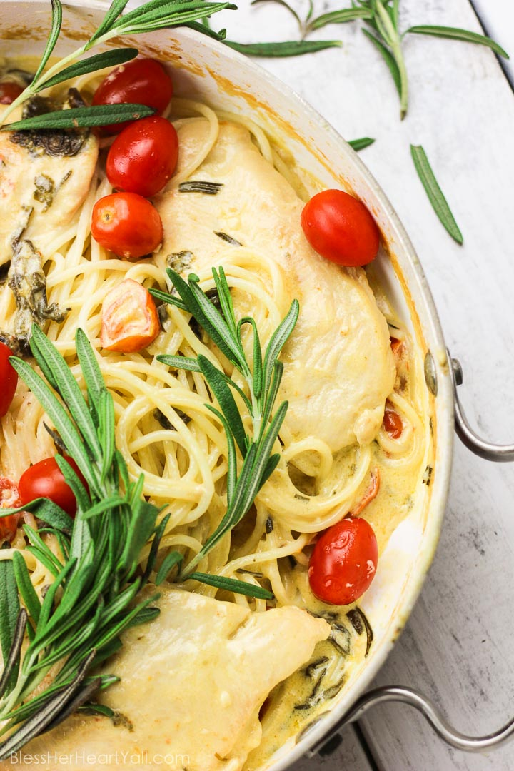 This one-pot rosemary goat cheese chicken pasta skillet is a cheesy, creamy, 30-minute meal with bold flavors! This pasta skillet incorporates garlic, cream, goat cheese, and rosemary as a base for the creamy sauce. Then gluten-free noodles, chicken breasts, and fresh tomatoes and spinach leaves are mixed together and smothered in this hearty and flavorful sauce! www.blessherheartyall.com