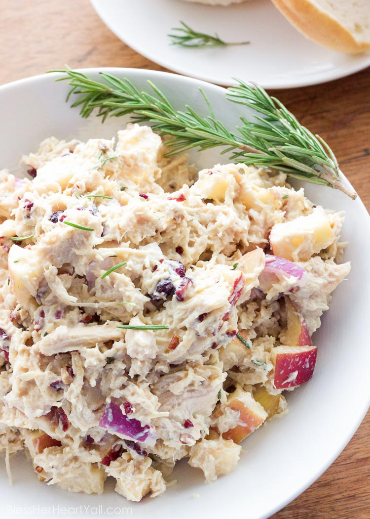 OMG yum! This rosemary greek yogurt chicken salad is a light and fresh (and gluten-free!) approach to chicken salad! The list of healthy ingredients come together to make one sweet and savory masterpiece of a salad or gluten free sandwich!