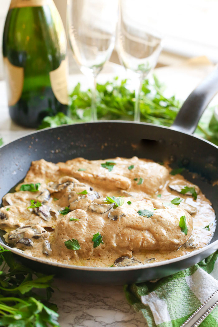 champagne chicken with mushrooms cooked in skillet on dinner table