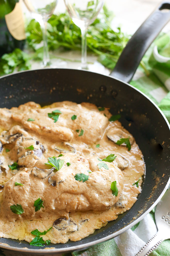 champagne chicken with mushrooms cooked in skillet