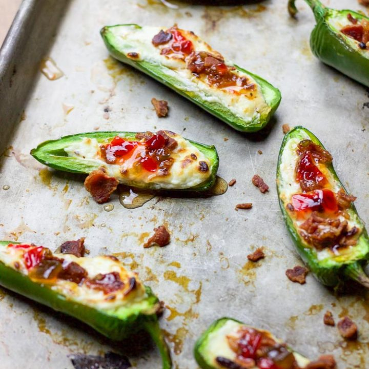 These bacon goat cheese jalapeno poppers are a fast and delicious little appetizer full of creamy goat cheese, crisp bacon crumbles, and sweet pepper jelly overtop quickly charred jalapenos for the perfect sweet and spicy party treat!