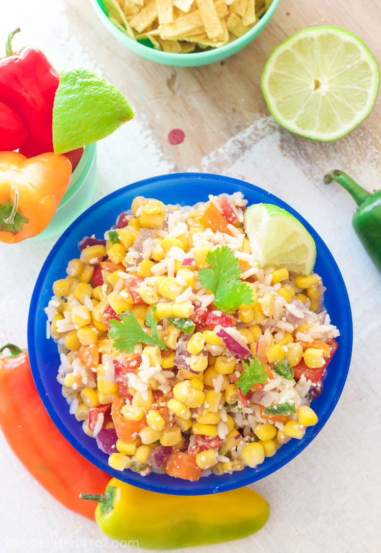 This easy mexican chopped corn salad combines fresh chopped summer veggies with a garlicky coconut lime vinaigrette and is a quick and refreshing dish for any warm-weathered gathering!