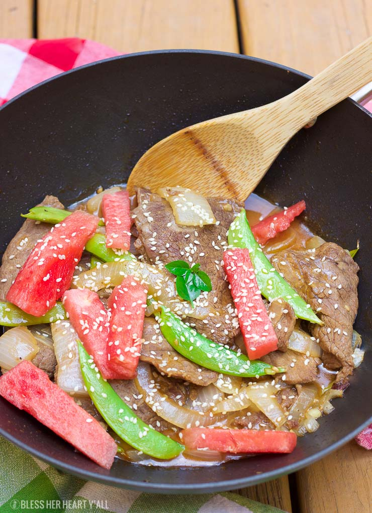 This simple watermelon stir-fry recipe combines the sweet refreshing flavors of juicy ripe watermelon with the savoury flavors of the asian-inspired stir-fry! The perfect-for-summer sauce has just a touch of sweet and light with it's combination of fresh lime juice and garlic. This summer dish definitely won't weigh you down in the sizzling heat!