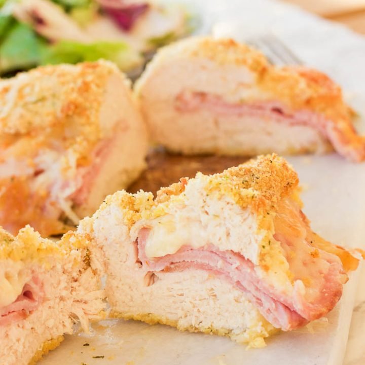 This gluten free chicken cordon bleu recipe is both quick and easy. Crunchy outer coating and juicy chicken in the middle, all topped with warm ham and ooey gooey melted swiss cheese! www.blessherheartyall.com