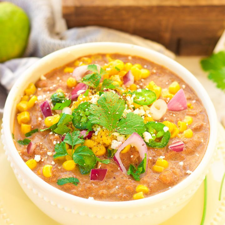 This slow cooker white turkey chili combines juicy leftover roasted turkey, chunky vegetables, and garlic, oregano, paprika, and spice to make a delicious stick-to-your-ribs meal that's so simple to make and so comforting to eat! It's also gluten free and low carb! www.blessherheartyall.com
