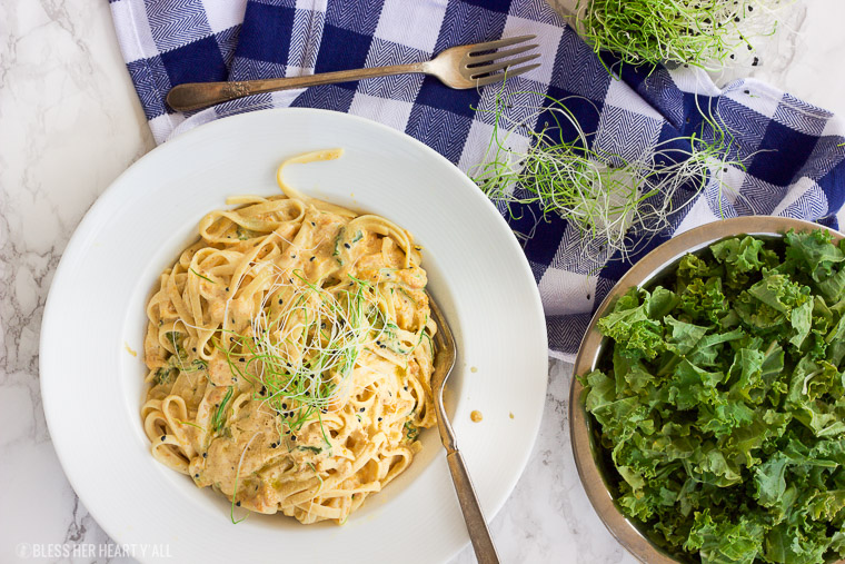 This vegan butternut squash pasta with kale and onion sprouts recipe is not only a showstopper, but it's packed full of nutrients and is also gluten-free, grain free, dairy free, and paleo friendly. Dive into this creamy savory dish in under 15 minutes! www.BlessHerHeartYall.com