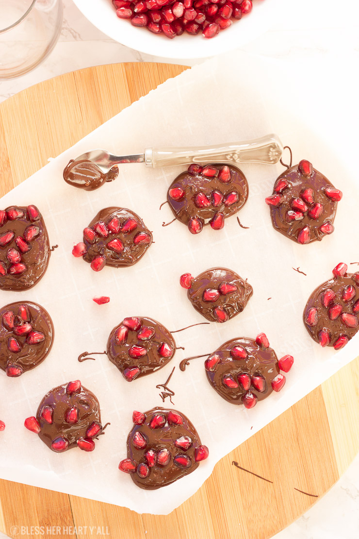 Dark chocolate pomegranate bites are the perfect quick and easy appetizer or sweet snack for the holiday season! Melted dark chocolate is sprinkled with pomegranate arils and sea salt before being allowed to harden and disappear.