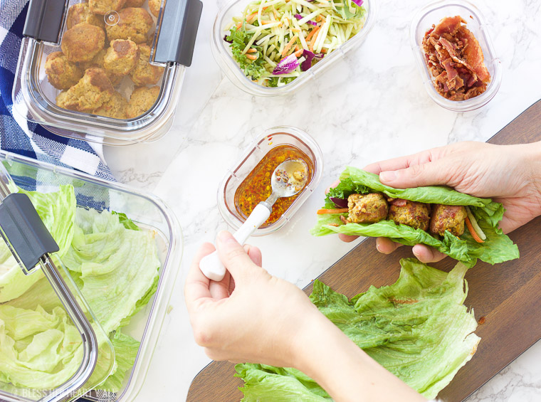 This pumpkin sage meatball lettuce wrap + hot bacon vinaigrette recipe is juicy and savory, with fresh crisp vegetables and moist round meatballs drizzled in a warm bacon dressing with a touch of heat!