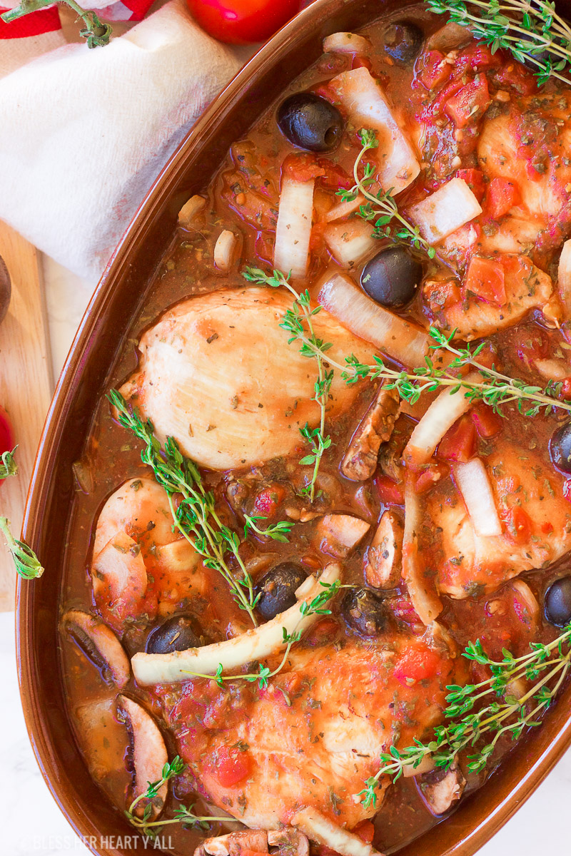 This gluten free slow cooker chicken cacciatore is a healthy dish that is prepped in under 10 minutes and slowly simmers all day in it's fragrant italian-inspired juices, filling your home with it's sweet garlicky and thyme aromas. It also has paleo and dairy-free options. This is the hearty, warm, juicy all-in-one meal that you've been waiting for!