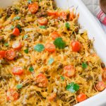 Spaghetti squash taco bake roasts fluffy spaghetti squash and melts it into seasoned ground meat, tomatoes, onion, corn, beans, and tops it off with melty cheese and fresh cilantro for the perfect healthy taco-inspired casserole!