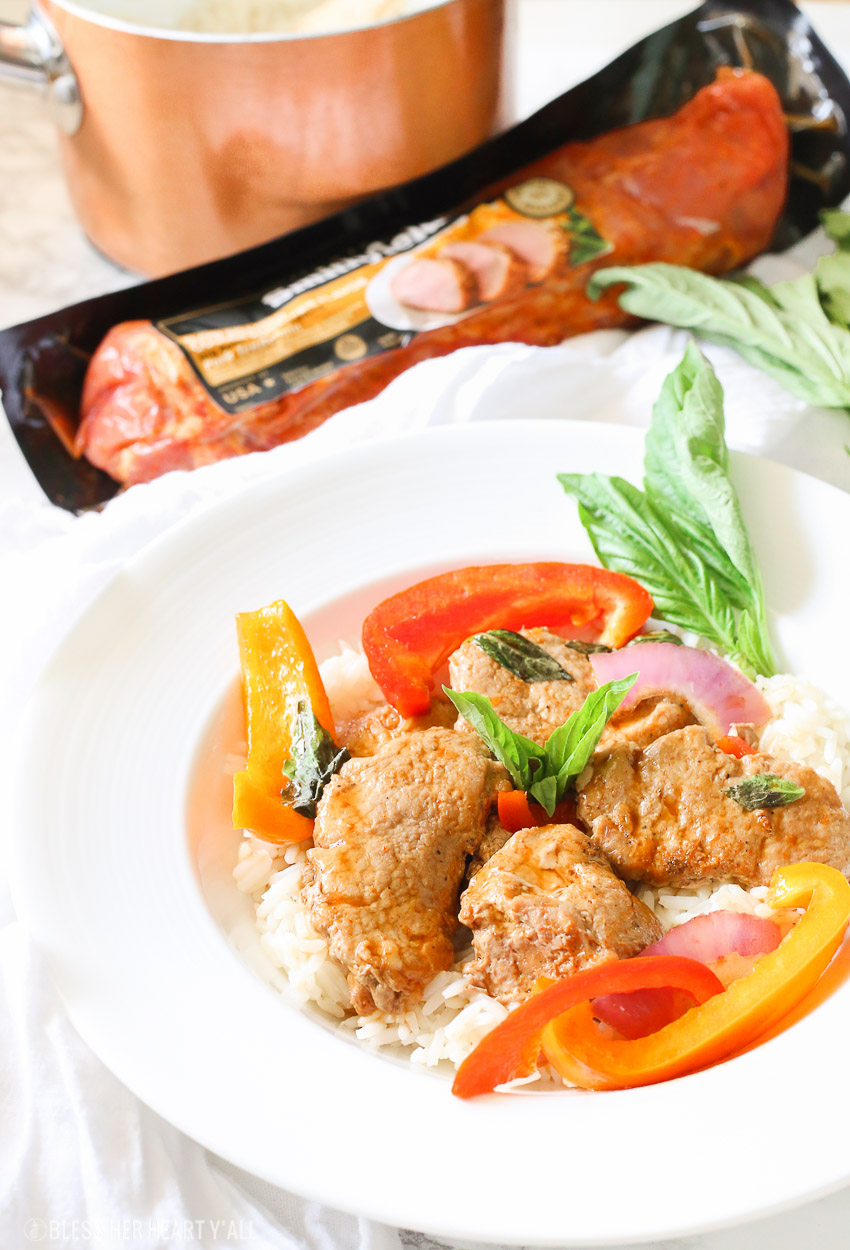 Tender juicy pork loin is cooked in a skillet with fresh vegetables and finished in an easy thai basil sauce all in under 30 minutes! This thai basil pork skillet is the perfect quick and easy weeknight meal that the whole family will love!