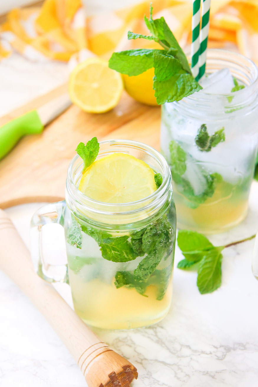 This lemonade mint julep recipe blends summer's most refreshing fresh squeezed lemonade and stirs it up into spring's hottest mint julep cocktail! Lemon, bourbon, mint, and sweet that's perfect for an outdoor party, watching the Kentucky Derby, or just a relaxing time outside on your back porch!