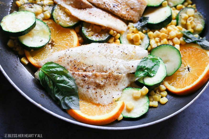 Only 7 ingredients and 20 minutes stand between you and this fresh sweet and savory orange basil butter sauce that's drizzled over your favorite white fish and vegetables!