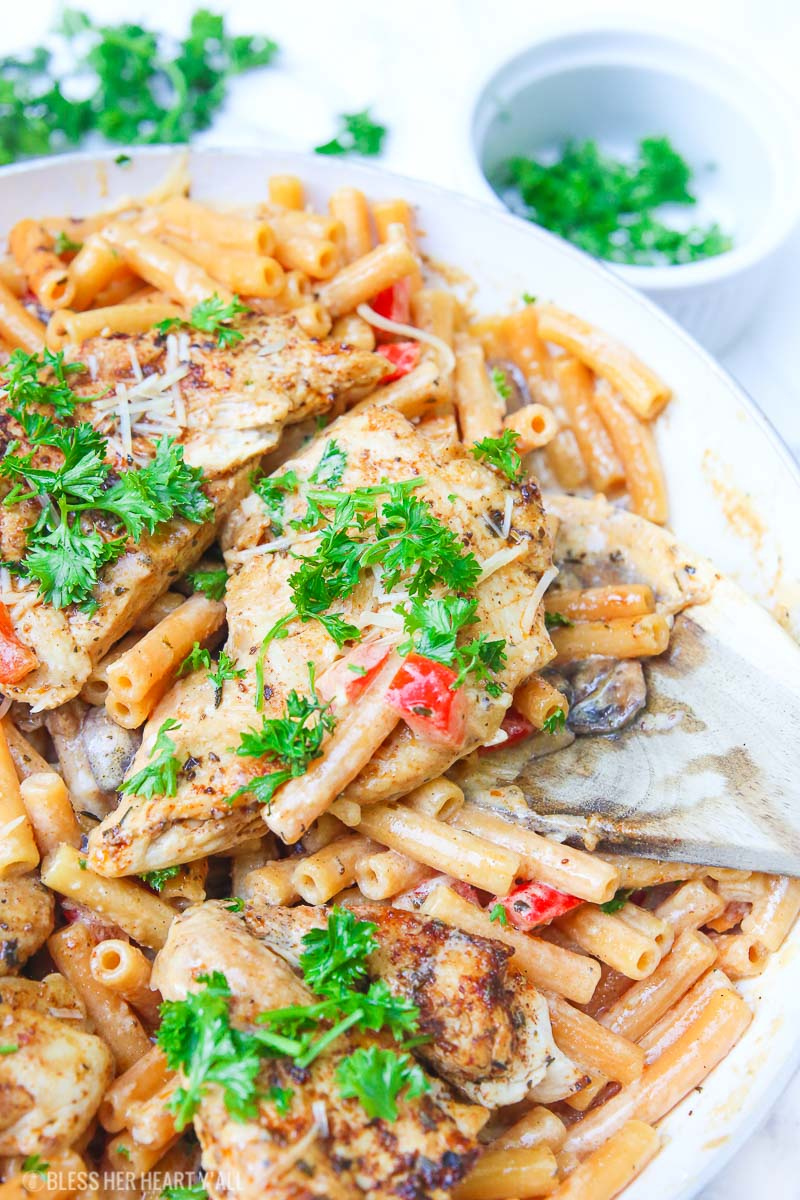 Cajun chicken pasta melts juicy cajun-seasoned chicken breasts with al dente gluten-free noodles in an easy creamy pasta sauce and sprinkled with extra gooey cheeses and herbs all in under 30 minutes! image 3