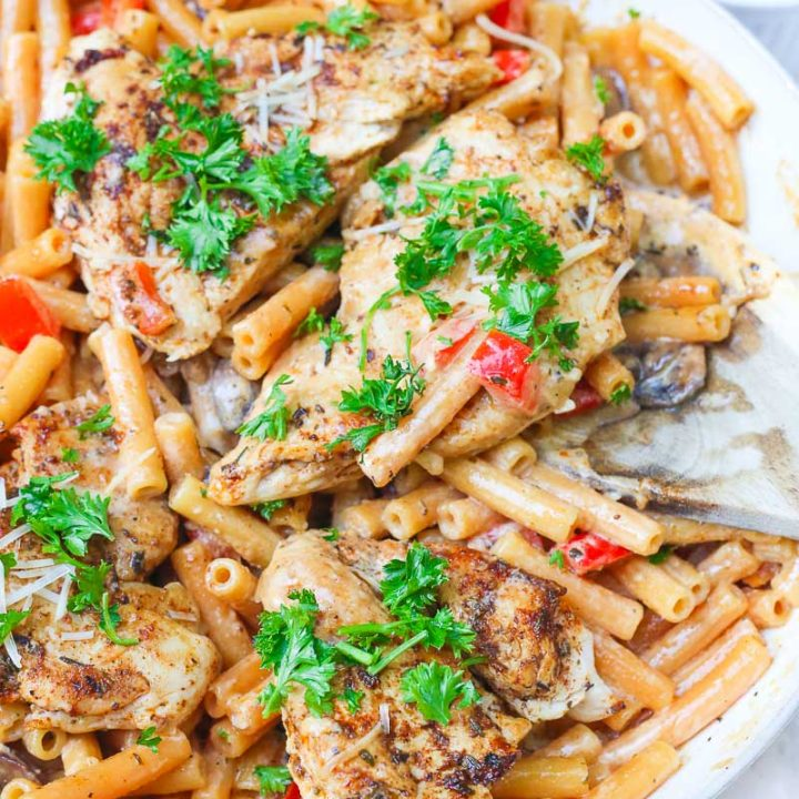 Cajun chicken pasta melts juicy cajun-seasoned chicken breasts with al dente gluten-free noodles in an easy creamy pasta sauce and sprinkled with extra gooey cheeses and herbs all in under 30 minutes! image 6