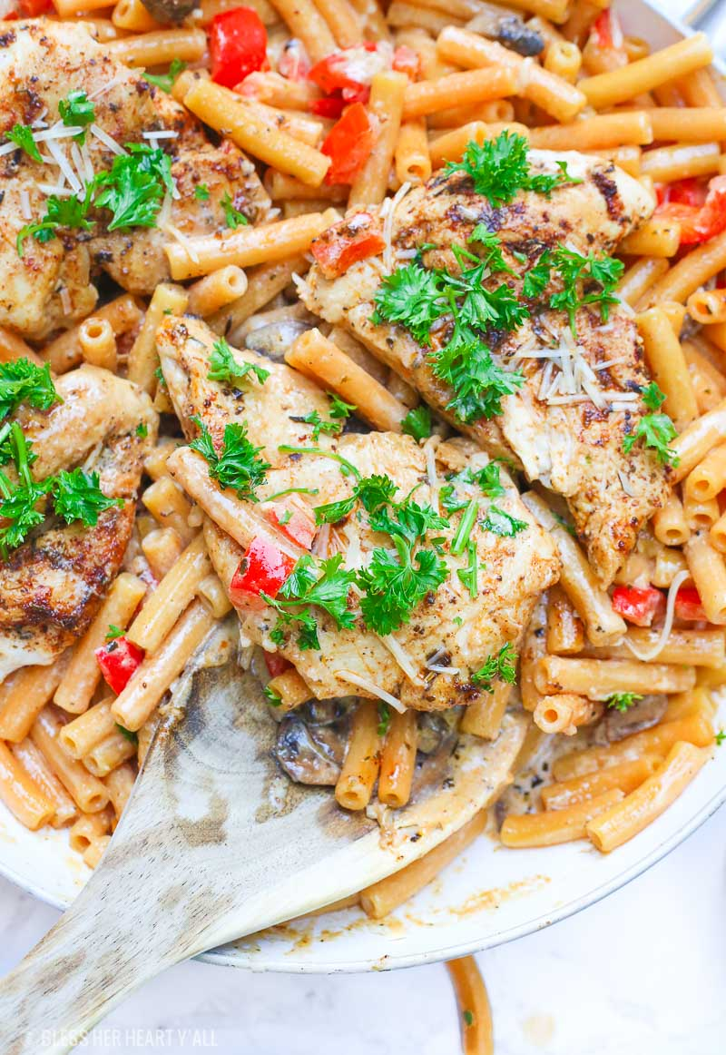Cajun chicken pasta melts juicy cajun-seasoned chicken breasts with al dente gluten-free noodles in an easy creamy pasta sauce and sprinkled with extra gooey cheeses and herbs all in under 30 minutes! image 7