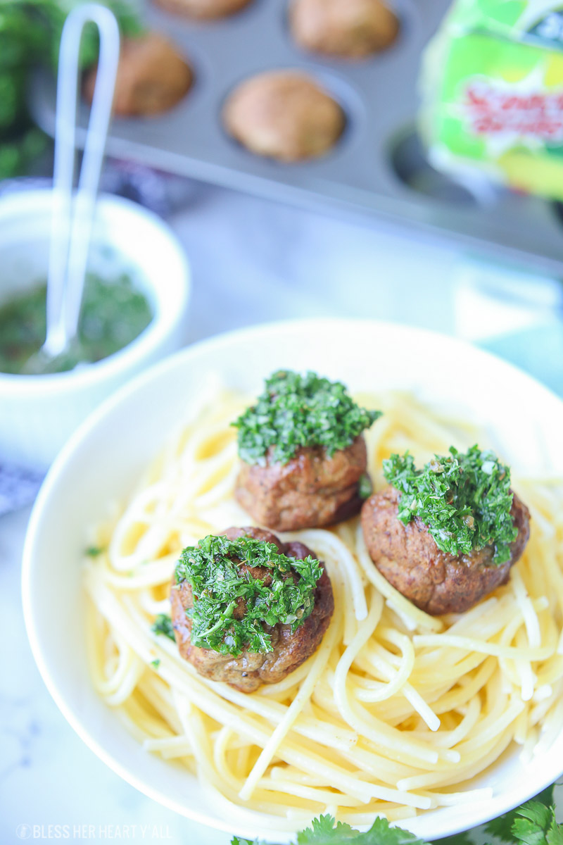 Chimichurri meatballs bake juicy bites of fresh beef and cilantro and then drizzle them with an easy homemade chimichurri sauce! This quick appetizer recipe is low carb, paleo, gluten free!