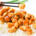 One-pan baked gluten-free sticky honey garlic chicken recipe is 100% gluten free and not fried in a frying pan for even a moment. Tender pieces of chicken are lightly breaded in a homemade spiced coating and then drizzled in coconut oil and a 5-ingredient sticky honey garlic sauce and then baked to perfection. image 6