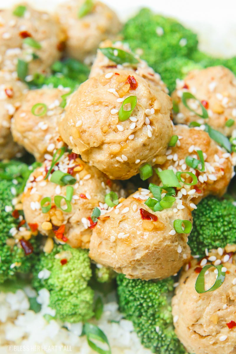 Sesame ginger paleo turkey meatballs bake soft paleo meatballs in a drizzle of homemade sweet and zesty sesame ginger sauce and topped with sesame seeds and green onion slivers. It's the perfect gluten-free, grain-free, and dairy-free appetizer or meal over rice and steamed vegetables! image 2