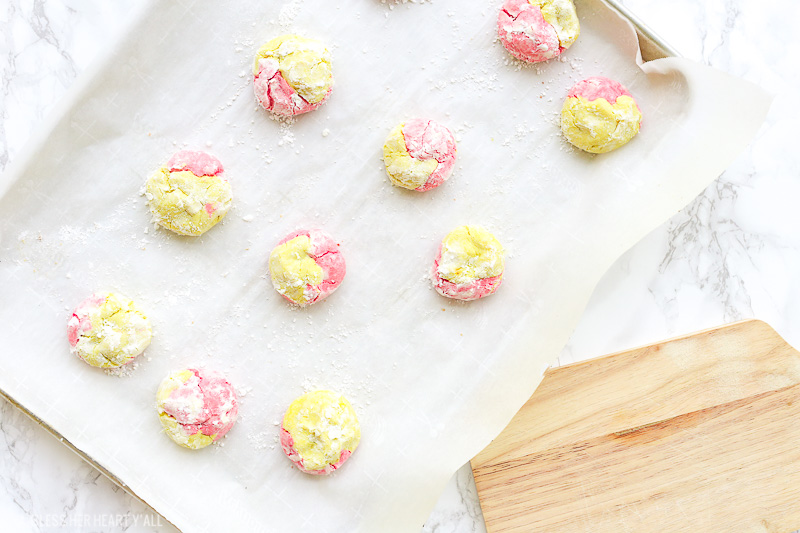 This strawberry lemonade cookie recipe combines zesty lemon flavors with sweet strawberry hints in a soft and fluffy crinkle cookie! These moist gluten free cookies are a great little snack or dessert all summer long! image 1