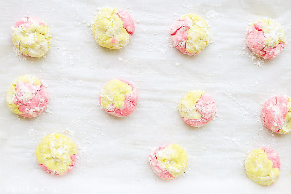 This strawberry lemonade cookie recipe combines zesty lemon flavors with sweet strawberry hints in a soft and fluffy crinkle cookie! These moist gluten free cookies are a great little snack or dessert all summer long! image 7