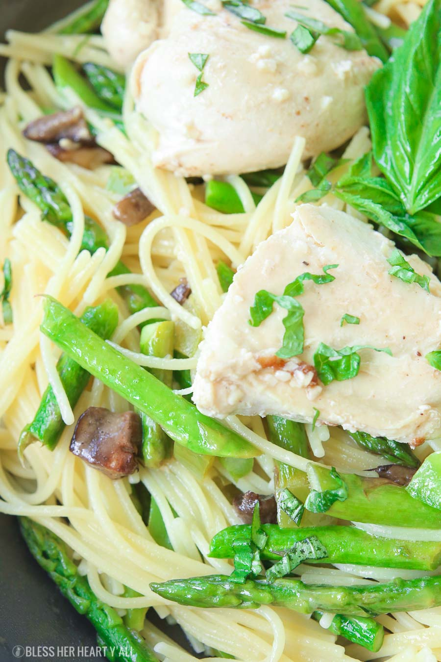 This chicken pasta in garlic basil butter sauce recipe makes for an easy gluten free dinner for busy weeknights. Pasta and chicken is tossed with the vegetables you already have in your kitchen and drizzled in a sizzling light and creamy garlic butter sauce with extra hints of basil and lemon! image 7