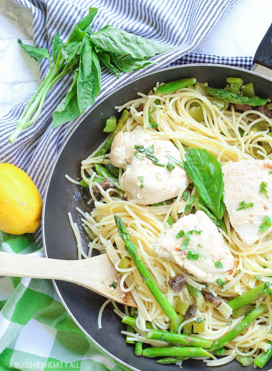 This chicken pasta in garlic basil butter sauce recipe makes for an easy gluten free dinner for busy weeknights. Pasta and chicken is tossed with the vegetables you already have in your kitchen and drizzled in a sizzling light and creamy garlic butter sauce with extra hints of basil and lemon! image 5
